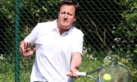 David Cameron playing tennis at Chequers